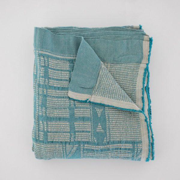Bogolan Bed throw Teal on linen