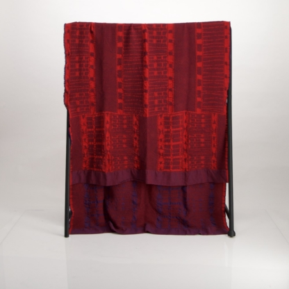 Jacquard woven cotton throw in blue and red