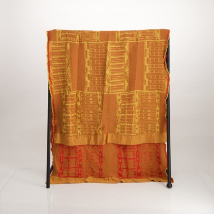 Jacquard woven cotton throw in yellow and red
