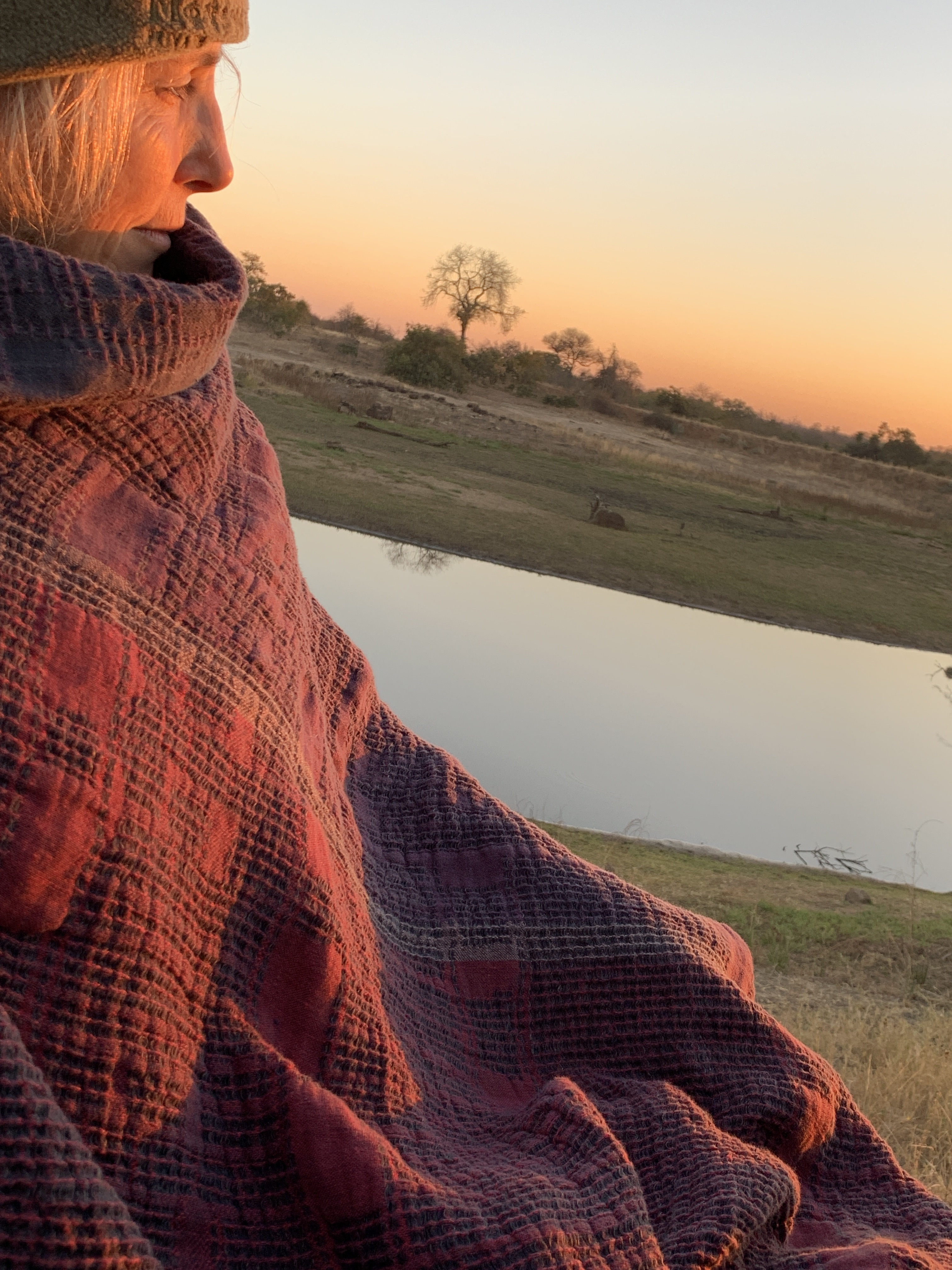 safari wearing lilac linen throw