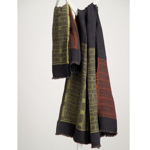 Chartreuse and rust on charcoal bogowrap linen scarf hanged on a coat rack