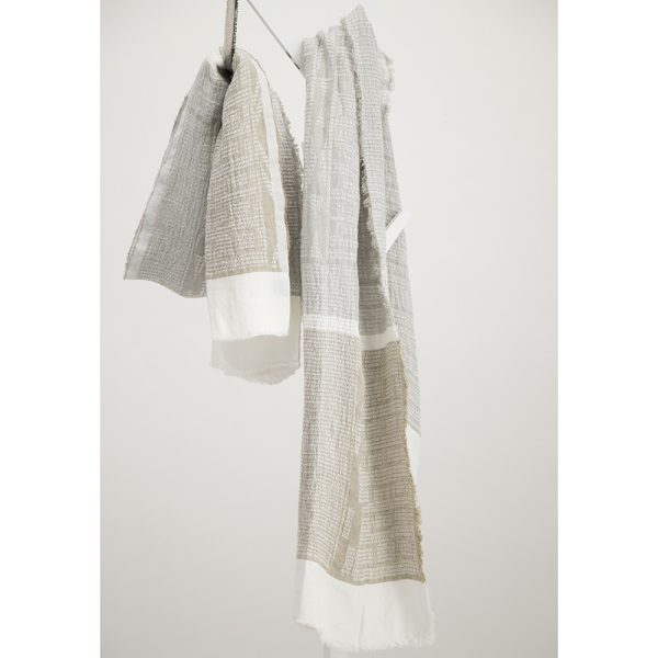 Desert beige and white bogowrap linen scarf hanged on a coat rack