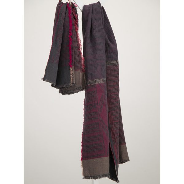 Lilac on charcoal linen bogowrap scarf hanged on a coat rack