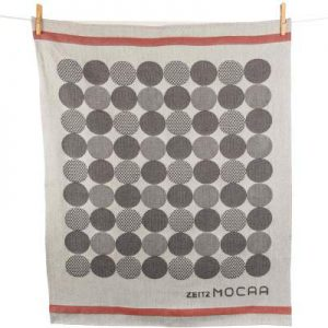 Customized tea towel for Mocaa Museum with jacquard woven circles in different shades of gray