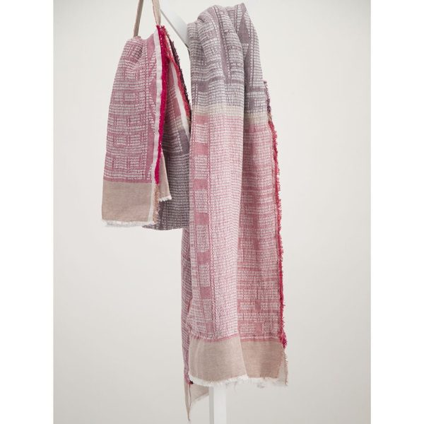 Lilac on white linen bogowrap scarf hanged on a coat rack