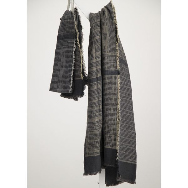 Metallic gray linen bogowrap scarf hanged on a coat rack