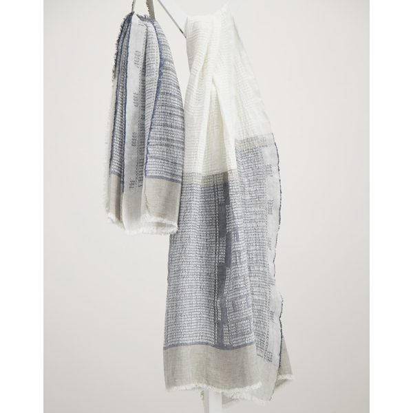 Navy and white bogowrap linen scarf hanged on a coat rack