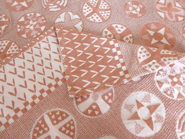 Customized cotton tablecloth in nude and white with jacquard woven Botswana basket design