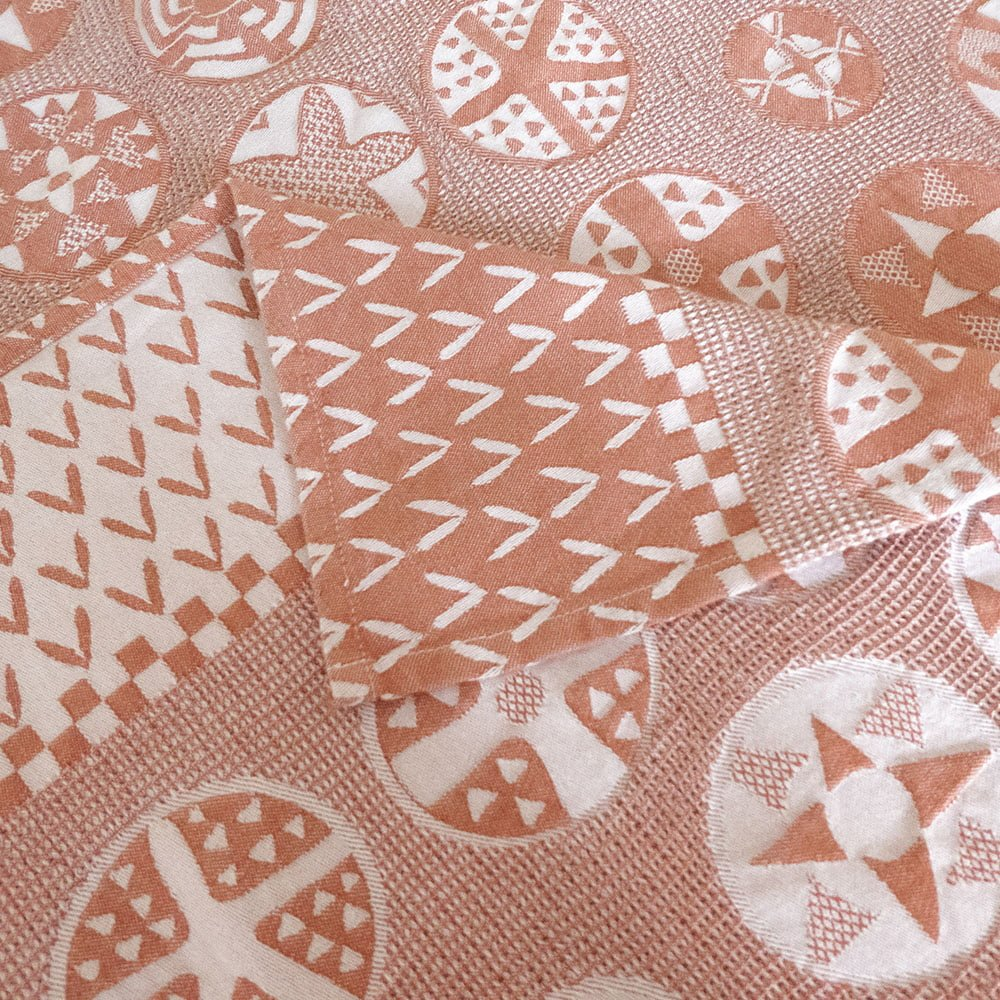 Customized tablecloth with jacquard woven Botswana basket pattern in nude and white