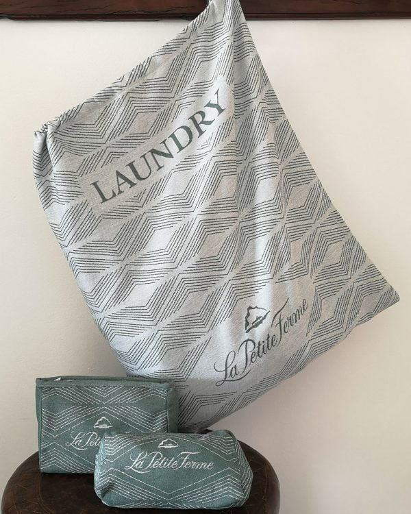 Customized hotel laundry bag and two toiletry bags in Jacquard woven green geometrical pattern.