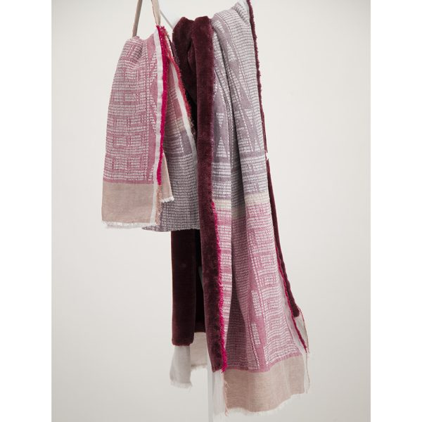 Lilac on white bogowrap scarf with faux fur lining hanged on coat rack