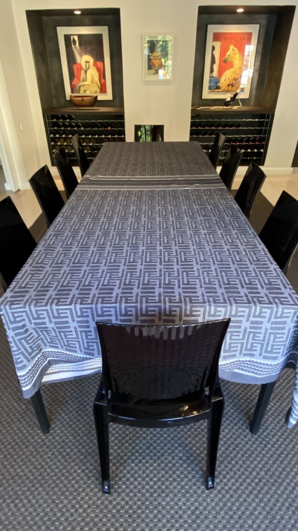 a table and chairs with a tablecloth in a diningroom