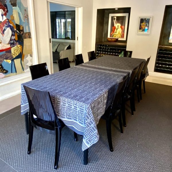 A table and chairs with table cloth in a dining room