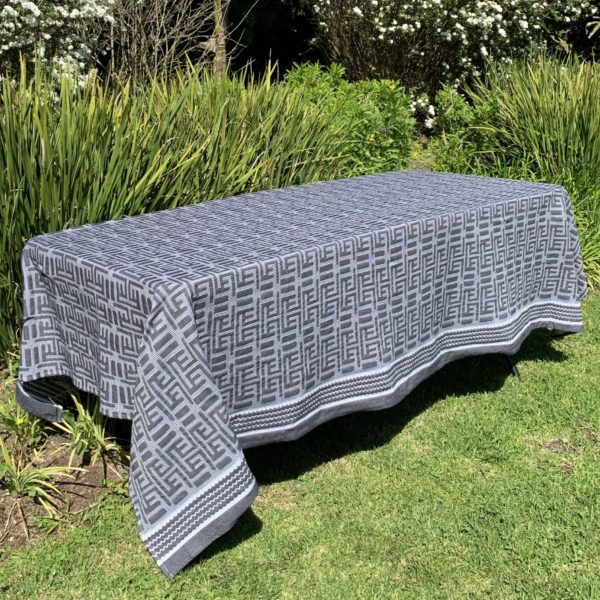 a tablecloth on a table in a garden