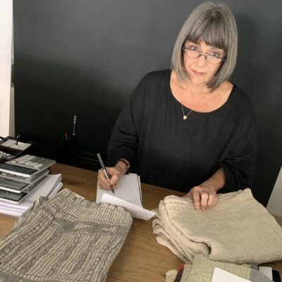Paulibe Mutlow taking notes and exposing home textiles